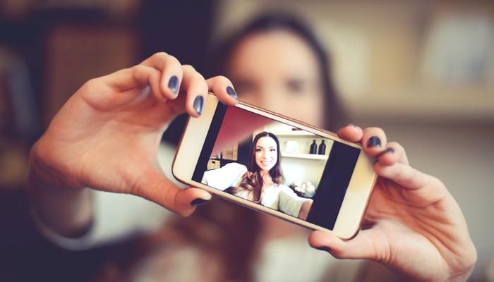 Student taking video with smartphone
